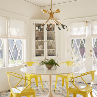 Inspiration for a transitional multicolored floor enclosed dining room remodel in Los Angeles with white walls and no fireplace