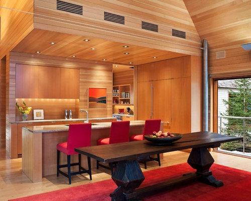 Example Of A Trendy Medium Tone Wood Floor Kitchen Dining Room Combo Design In Portland