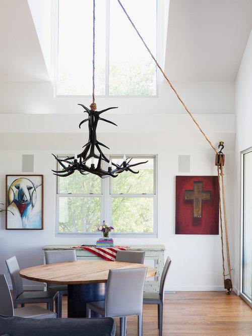 Minimalist Dining Room Photo In Kansas City With White Walls And Medium Tone Wood Floors
