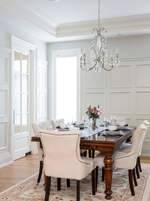 Elegant Medium Tone Wood Floor Dining Room Photo In Toronto With White Walls