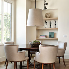 contemporary dining room by Bernard Andre Photography