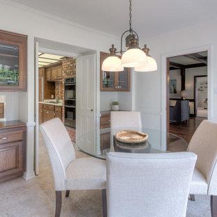 Immagine di una grande sala da pranzo aperta verso la cucina classica con pareti bianche, pavimento in vinile e pavimento beige