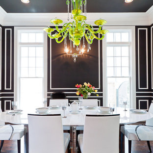 Example of a trendy dark wood floor enclosed dining room design in Houston with black walls