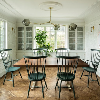 Enclosed dining room - mid-sized transitional dark wood floor and brown floor enclosed dining room idea in Portland with white walls