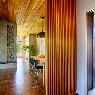 Photo of a midcentury dining room in Portland.