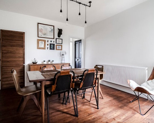 Photo Of A Scandi Enclosed Dining Room In London With White Walls Dark Hardwood Flooring