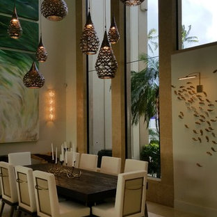 Inspiration for a large tropical open plan dining in Hawaii with beige walls, limestone floors and no fireplace.