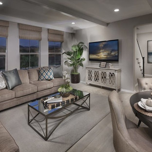 Photo of an expansive traditional open plan dining room in Orange County with grey walls, laminate floors and grey floors.