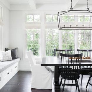 На фото: столовая в стиле современная классика с белыми стенами, темным паркетным полом, коричневым полом и кессонным потолком с