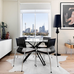 Design ideas for a contemporary open plan dining in Sydney with white walls and light hardwood floors.
