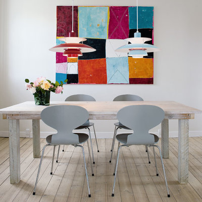 Inspiration for a contemporary dining room remodel in Sydney with white walls