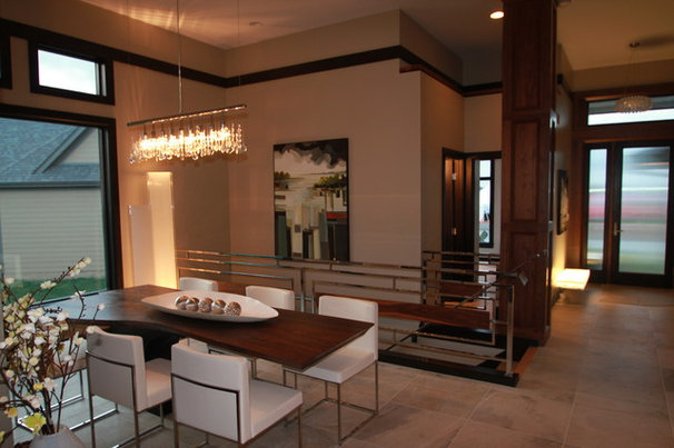 Modern Dining Room by Jerry Bussanmas