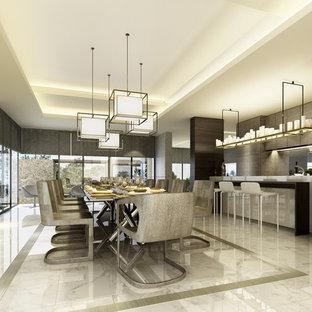 Diseño de comedor de cocina actual, grande, sin chimenea, con paredes beige y suelo de mármol