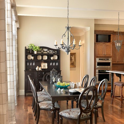 Kitchen/dining room combo - traditional dark wood floor and brown floor kitchen/dining room combo idea in St Louis with beige walls