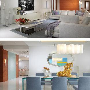 Ejemplo de comedor moderno, de tamaño medio, abierto, con paredes blancas y suelo de mármol