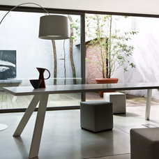 Contemporary Dining Room by IQmatics