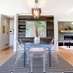 Great room - contemporary medium tone wood floor great room idea in Minneapolis with white walls