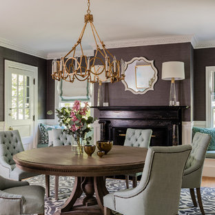 Example of a transitional light wood floor and beige floor dining room design in Boston with white walls and a standard fireplace