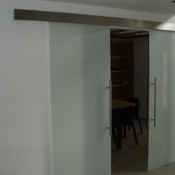 Private residence in NJ - Double glass door sliding on wall, made in Italy, gableboard in stainless steel