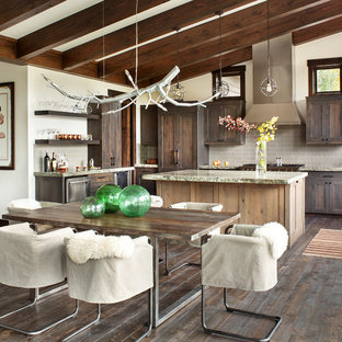 Example of a mountain style dark wood floor kitchen/dining room combo design in Other with white walls