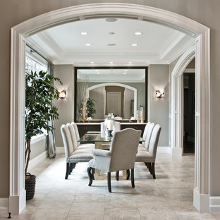 Enclosed dining room - mid-sized transitional limestone floor and gray floor enclosed dining room idea in Seattle with gray walls
