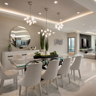 Example of a trendy white floor dining room design in Miami with beige walls