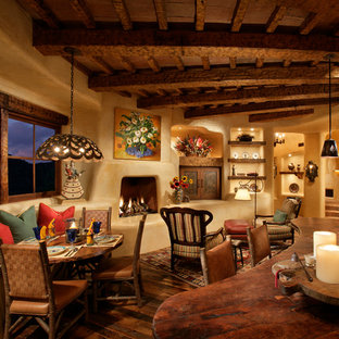 Great room - small rustic dark wood floor and brown floor great room idea in Phoenix with beige walls and a standard fireplace