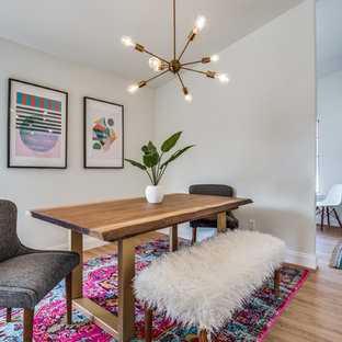 Great room - small mid-century modern light wood floor and brown floor great room idea in Dallas with white walls