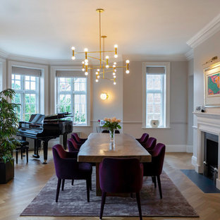 Design ideas for a large classic dining room in London with grey walls, light hardwood flooring and beige floors.