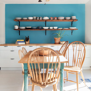 Inspiration for a beach style dining room remodel in New York