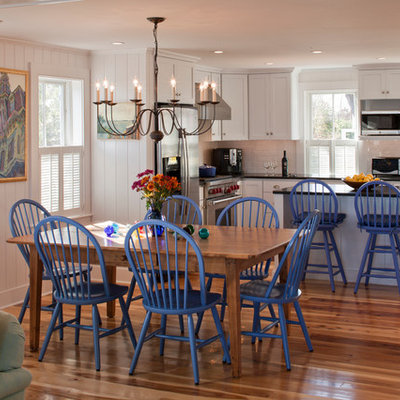 Great room - mid-sized coastal medium tone wood floor great room idea in Boston with beige walls and no fireplace