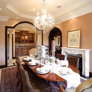 Новые идеи обустройства дома: большая отдельная столовая в классическом стиле с бежевыми стенами, ковровым покрытием, камином, фасадом камина из штукатурки и фиолетовым полом