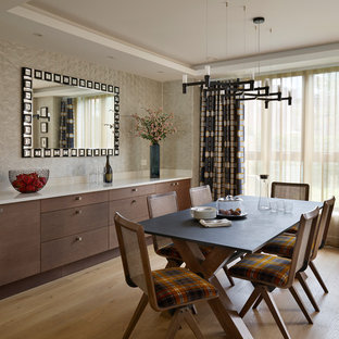 Photo of a classic dining room in London with beige walls, light hardwood flooring and brown floors.