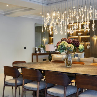 Inspiration for a large classic open plan dining room in Other with white walls, grey floors and a coffered ceiling.