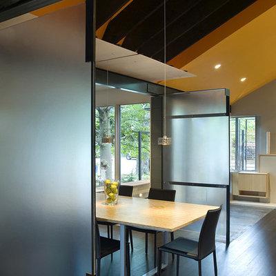Example of a trendy dark wood floor dining room design in DC Metro