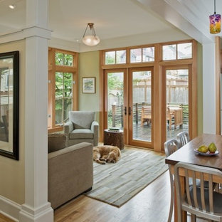 Example of a mid-sized arts and crafts light wood floor great room design in Seattle with beige walls