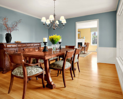 Example Of A Classic Medium Tone Wood Floor Enclosed Dining Room Design In Seattle With Blue