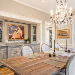 Large elegant medium tone wood floor enclosed dining room photo in Seattle with beige walls and no fireplace