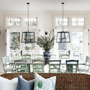 Inspiration for a coastal dining room in Sydney with beige walls, painted wood flooring and white floors.