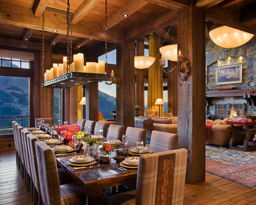 Attractive Example Of A Mountain Style Dark Wood Floor Dining Room Design In Other