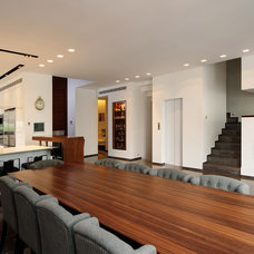 Modern Dining Room by Moshi Gitelis - Photographer