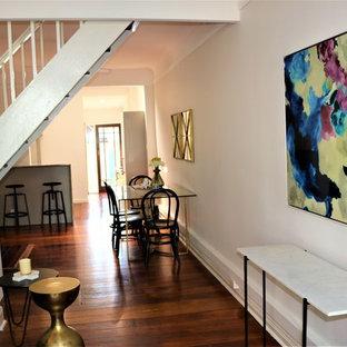 ニューカッスルの小さいヴィクトリアン調のおしゃれなLDK (グレーの壁、淡色無垢フローリング、標準型暖炉、木材の暖炉まわり) の写真