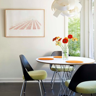 Dining room - modern dark wood floor dining room idea in Los Angeles with white walls