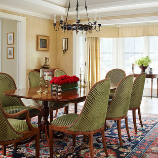 Enclosed dining room - traditional enclosed dining room idea in Milwaukee with yellow walls