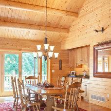Rustic Dining Room by Katahdin Cedar Log Homes