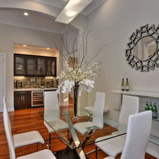 Contemporary Dining Room by Staging Artists