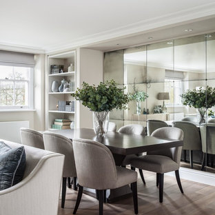 Medium sized classic dining room in London with beige walls, light hardwood flooring and beige floors.