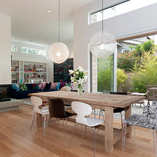 Dining room - modern dining room idea in Vancouver with a corner fireplace