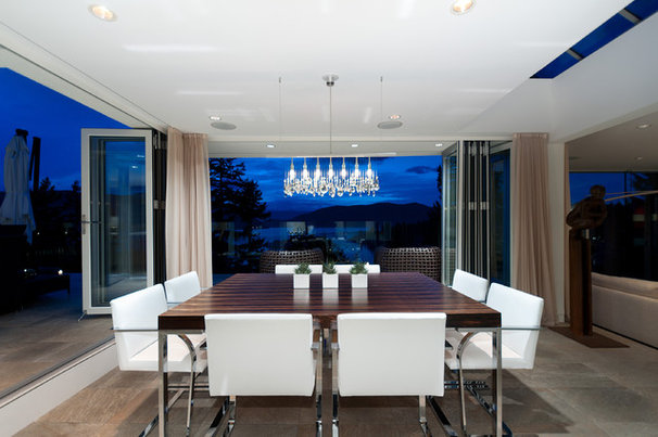 Contemporary Dining Room by blurrdMEDIA