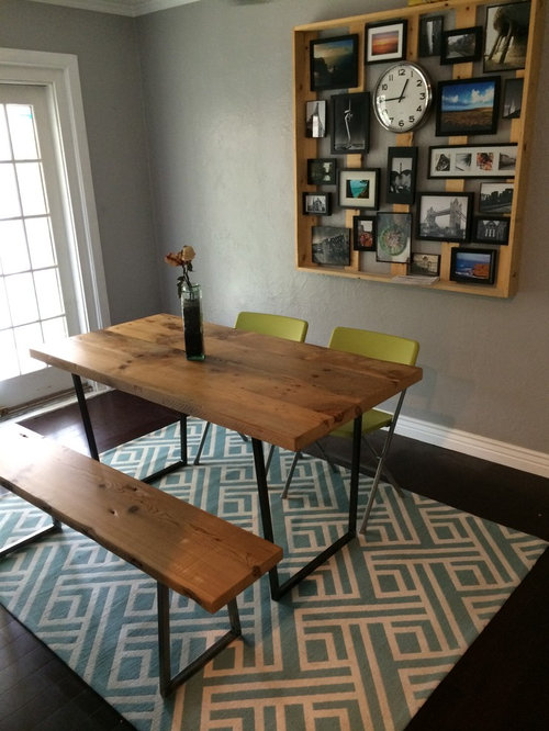 Reclaimed wood table in a Small dining room